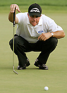 Golfer Phil Mickelson, of the United States, lines up a putt during the first round of the 2005 PGA Championship at Baltusrol Golf Club in Springfield, New Jersey, Thursday 11 August 2005.