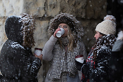 Three women covered in snow enjoy a sip of coffee as a  snow flurry hits Westminster at Horseguards. Westminster, London, February 27 2018.