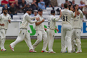 Rikki Clarke (Warwickshire County Cricket Club) is congratulated after taking the wicket of Michael Richardson  during the LV County Championship Div 1 match between Durham County Cricket Club and Warwickshire County Cricket Club at the Emirates Durham ICG Ground, Chester-le-Street, United Kingdom on 14 July 2015. Photo by George Ledger.