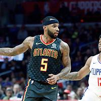 08 January 2018: Atlanta Hawks guard Malcolm Delaney (5) drives past LA Clippers guard Tyrone Wallace (12) during the LA Clippers 108-107 victory over the Atlanta Hawks, at the Staples Center, Los Angeles, California, USA.