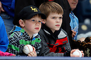 Royals fans, Clayton Kepner, 10, and his brother, six-year-old, Conner, watch batting practice from the stands before a baseball game against the Chicago White Sox at Kauffman Stadium in Kansas City, Mo., Saturday, May 4, 2013.  (AP Photo/Colin E. Braley).