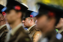 Soldiers from the Rifles wear poppies in their hats while on parade during a Remembrance Sunday service in Queen's Square, Bristol, held in tribute for members of the armed forces who have died in major conflicts.