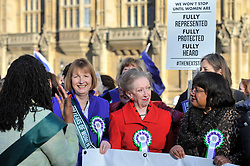 © Licensed to London News Pictures. 06/02/2018. LONDON, UK.  Harriet Harman, Margaret Beckett and Diane Abbott join female members of the Shadow Cabinet and Labour politicians outside the Houses of Parliament, wearing Labour styled suffragette rosettes, holding placards next to a '100 Years of Women Voting' banner to help launch Labour's campaign to celebrate 100 years of women's suffrage.    Photo credit: Stephen Chung/LNP