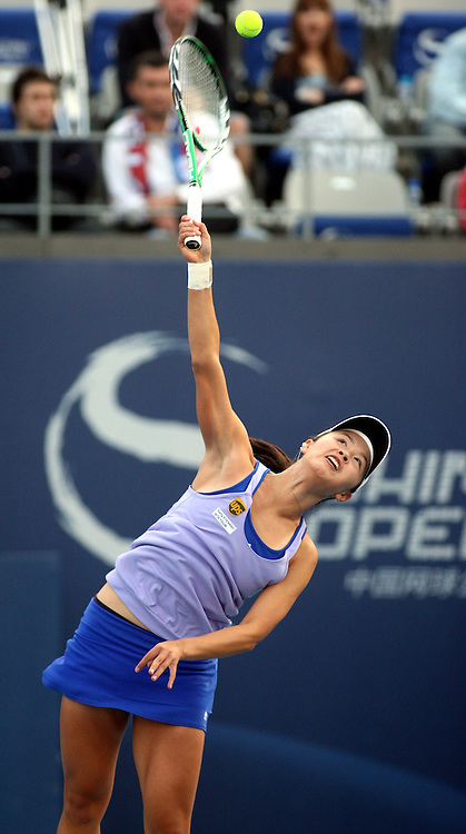 Oct 06, 2009, Beijing, China, Peng Shuai of China defeats Jelena Jankovic of Serbia 2:1 in the second round of China Open at the National Tennis Center.