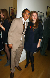 Footballer THEO WALCOTT and PRINCESS BEATRICE OF YORK at the opening of an exhibition entitled Exceptional Youth supported by Teen Vogue at the National Portrait Gallery, London on 3rd November 2006.<br />