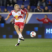 HARRISON, NEW JERSEY- APRIL 24: Mike Grella #13 of New York Red Bulls, beats goalkeeper Joseph Bendik #1 of Orlando City FC for New York Red Bulls first goal during the New York Red Bulls Vs Orlando City MLS regular season match at Red Bull Arena, Harrison, New Jersey on April 24, 2016 in New York City. (Photo by Tim Clayton/Corbis via Getty Images)