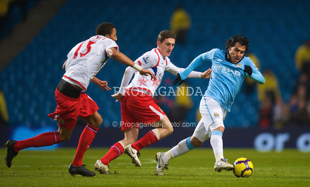 MANCHESTER, ENGLAND - Monday, January 11, 2010: Manchester City's Carlos Tevez in action against Blackburn Rovers during the Premiership match at the City of Manchester Stadium. (Photo by David Rawcliffe/Propaganda)
