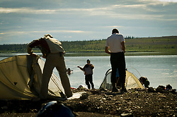 Dene First Nation youth out up their tents along the Thelon river In the middle of the largest and most remote game sanctuary in North America, in the Northwest Territories, just south of the Arctic Circle. Its fate now hangs in the balance, protected on paper, but with little management, no money, and no voice for the Dene, its most ardent advocate for protection, while mining (for diamonds, gold, and uranium) threats, buoyed by recent prices, loom. Dene youth have rarely been deep into the Thelon, yet the caribou is still their life blood, reverentially important. These Dene are amongst the last hunter/gatherers in the Northern Hemisphere. (Photo by Ami vitale)