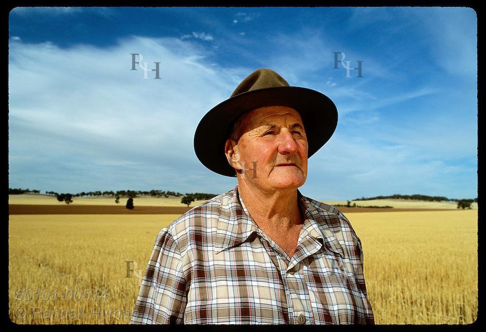Farmer Jack Veitch surveys fields of alfalfa stubble on his farm in Coolamon, New South Wales. Australia