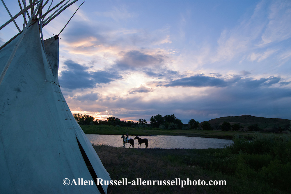 Crow Indian waters horse in Little Bighorn River, tipi, Crow Indian Reservation, Montana