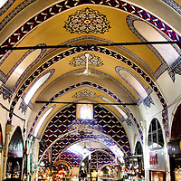 Kapaliçarşi Grand Bazaar Ceiling in Istanbul, Turkey<br /> The Grand Bazaar, called Kapaliçarşi in Turkish, is an enormous, old covered market in Istanbul, Turkey.  It consists of over 3,000 shops across 75 acres that employs over 25,000 people to serve the quarter-million plus shoppers that visit daily.  Its origins date back to the 15th century when the Ottomans ruled over Constantinople.  The buildings are built from brick and stone.  The arched ceilings are brightly painted and have large windows for providing the primary means of lighting.