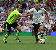 Jamie O'Hara beating Dale Stephens during the Sky Bet Championship match between Fulham and Brighton and Hove Albion at Craven Cottage, London, England on 15 August 2015. Photo by Matthew Redman.