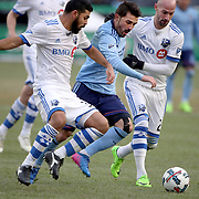 NEW YORK, NEW YORK - March 18:  David Villa #7 of New York City FC is challenged by Laurent Ciman #23 of Montreal Impact and Victor Cabrera #36 of Montreal Impact during the New York City FC Vs Montreal Impact regular season MLS game at Yankee Stadium on March 18, 2017 in New York City. (Photo by Tim Clayton/Corbis via Getty Images)