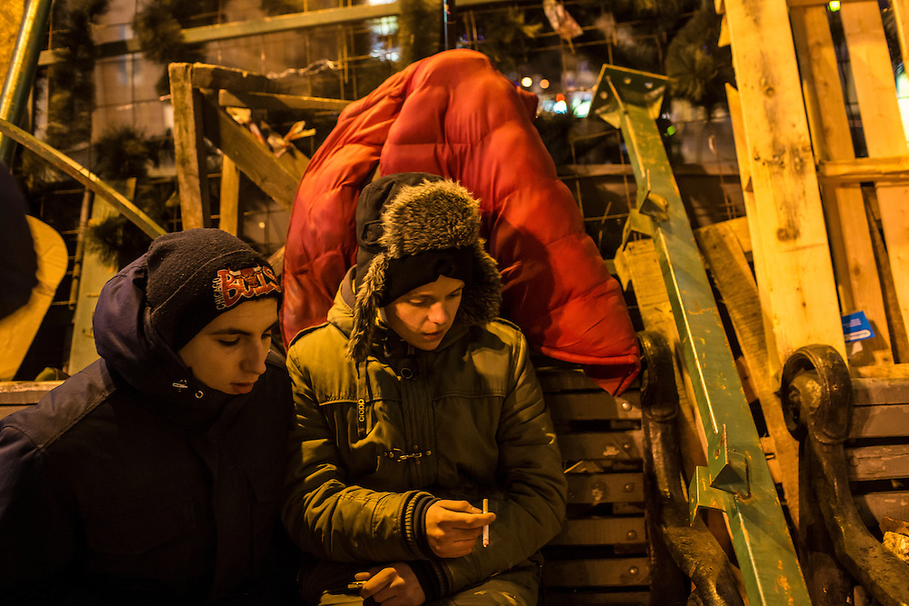 KIEV, UKRAINE - DECEMBER 3: Protesters rest against a barricade during ongoing anti-government protests in Independence Square on December 3, 2013 in Kiev, Ukraine. Thousands of people have been protesting against the government since a decision by Ukrainian president Viktor Yanukovych to suspend a trade and partnership agreement with the European Union in favor of incentives from Russia. (Photo by Brendan Hoffman/Getty Images) *** Local Caption ***