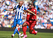 Brighton defender Bruno Saltor and Blackburn Rovers player Fode Koita battle for possession during the Sky Bet Championship match between Brighton and Hove Albion and Blackburn Rovers at the American Express Community Stadium, Brighton and Hove, England on 22 August 2015. Photo by Bennett Dean.