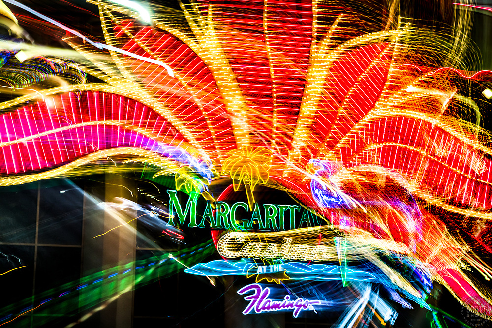 """""""Las Vegas Lights 10"""" - Photograph taken at the Las Vegas, Nevada Strip at night. The look was achieved by shooting a handheld long exposure and zooming the lens during the exposure."""