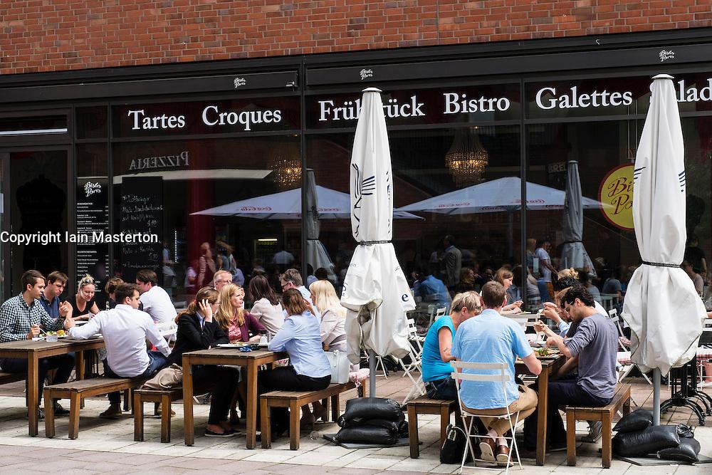 Office workers on lunch break at modern restaurant in new Uberseequaartier Hafencity property development in Hamburg Germany