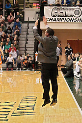 01 March 2014: Mike Schauer does jumping jacks while frantically calling for a time out during an NCAA mens division 3 CCIW  Championship basketball game between the Wheaton Thunder and the Illinois Wesleyan Titans in Shirk Center, Bloomington IL