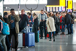 © Licensed to London News Pictures. 10/12/2017. London, UK. Passengers wait for their delayed and cancelled flights at Heathrow Airport Terminal 5 as the flights to and from Heathrow Airport have been affected by snow in London on Sunday, 10 December 2017. Photo credit: Tolga Akmen/LNP