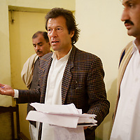 Imran Khan and members of his polical party Tehrik-e-insaaf meet Khan's constituents in the village of Qamar Mashani. Imran Khan became a Member of the Pakistani Parliament for Mianwali, Panjab, in the October 2002 elections.<br /> <br /> Cricketer Imran Khan made his Test debut against England in 1971. He became captain of the Pakistan team in 1982 and lead them to World Cup victory in 1992 after which he retired.<br /> <br /> Imran Khan established the Tehrik-e-insaaf (or Moverment for Justice) in 1996. Through Tehrik-e-insaaf, Khan has demanded that the Pakistan government make institutional reforms to address corruption and end the present dictatorship. Khan would like a more equitable distribution of resources in Pakistan, the granting key civil liberties and an increas in public service spending. He is particularly scathing of the relationship between President Musharraf and US President Bush.<br /> <br /> Photo: Tom Pietrasik<br /> Panjab, Pakistan<br /> 28th January 2006