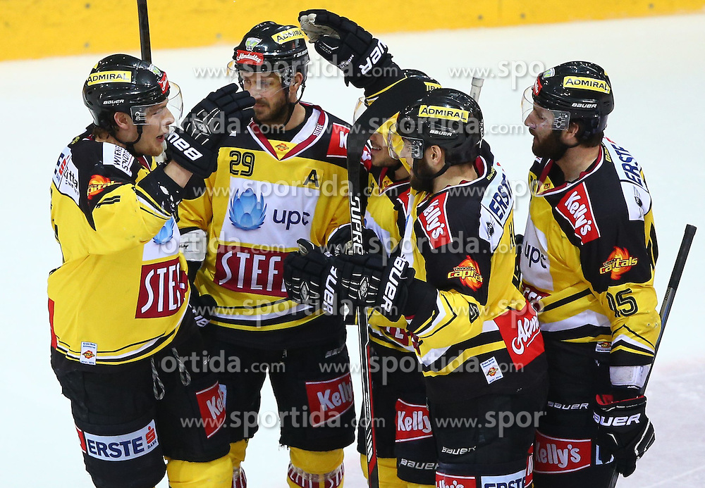 29.03.2015, Albert Schultz Eishalle, Wien, AUT, EBEL, UPC Vienna Capitals vs EHC Liwest Linz, Playoff, im Bild Torjubel Patrick Peter (UPC Vienna Capitals), Sven Klimbacher (UPC Vienna Capitals), Rafael Rotter (UPC Vienna Capitals) und Danny Bois (UPC Vienna Capitals) // during the Erste Bank Icehockey League playoff match between UPC Vienna Capitals and EHC Liwest Linz at the Albert Schultz Ice Arena, Vienna, Austria on 2015/03/29. EXPA Pictures © 2015, PhotoCredit: EXPA/ Thomas Haumer