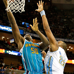 October 29, 2010; New Orleans, LA, USA; New Orleans Hornets center Emeka Okafor (50) shoots over Denver Nuggets power forward Shelden Williams (23)during the fourth quarter at the New Orleans Arena. The Hornets defeated the Nuggets 101-95.  Mandatory Credit: Derick E. Hingle