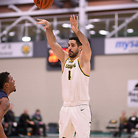 5th year guard Alex Igual (4) of the Regina Cougars during the Men's Basketball home game on January 5 at Centre for Kinesiology, Health and Sport. Credit: Arthur Ward/Arthur Images