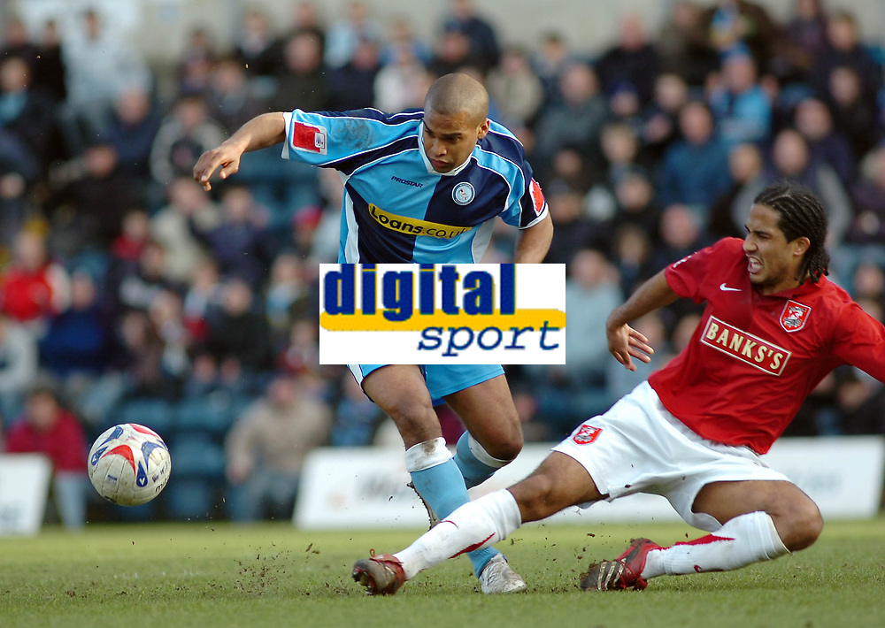 Photo: Kevin Poolman.<br />Wycombe Wanderers v Walsall. Coca Cola League 2. 17/03/2007. Jermaine Easter of Wycombe (left) is tackled by Chris Westwood of Walsall.