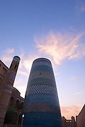 Uzbekistan, Khiva, Ichon-Qala.<br /> Kalta Minor Minaret at sunset..