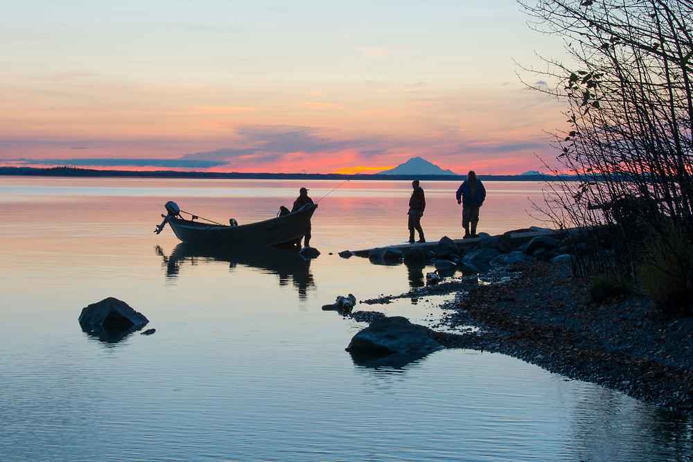Fisherman come ashore to pull their drift boat out after a long day fishing the famous Kenai River