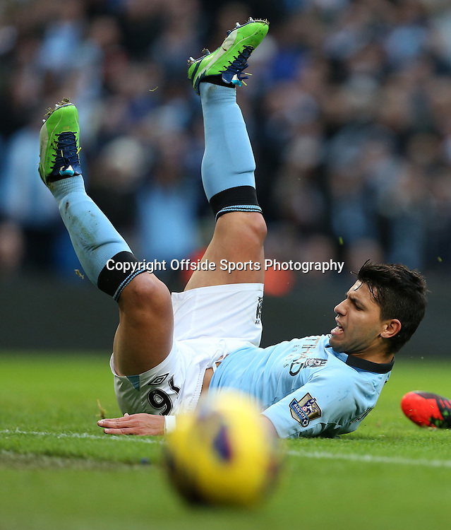 9th December 2012 - Barclays Premier League - Manchester City vs. Manchester United - Sergio Aguero of Man City slides along the grass as the ball runs away from him - Photo: Simon Stacpoole / Offside.