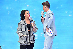 Demi Lovato and Roman Kemp during Capital's Summertime Ball with Vodafone at Wembley Stadium, London. This summer's hottest artists performed live for 80,000 Capital listeners at Wembley Stadium at the UK's biggest summer party. Performers included Camila Cabello, Shawn Mendes, Rita Ora, Charlie Puth, Jess Glyne, Craig David, Anne-Marie, Rudimental, Sean Paul, Clean Bandit, James Arthur, Sigala, Years & Years, Jax Jones, Raye, Jonas Blue, Mabel, Stefflon Don, Yungen and G-Eazy