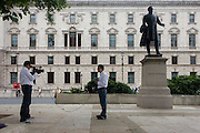 A Columbian news team of reporter and camera technician stand beneath the statue of the Victorian Lord Palmerston for a piece to camera after another day of competition at the London 2012 Olympics. .Viscount Palmerston was a title in the Peerage of Ireland created on 12 March 1723, along with the subsidiary title Baron Temple of Mount Temple (County Sligo). Upon the death of the third Viscount (who served as Prime Minister of the United Kingdom), the title became extinct.