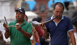 July 27, 2017 - Kathmandu, Nepal - A man from Newar community blows horn along with traditional music at Swayambhunath during a month-long Gunla festival in Kathmandu, Nepal. Newar Buddhists visit religious places playing devotional musics in Gunla festival, which falls in the mid of monsoon. (Credit Image: © Archana Shrestha/Pacific Press via ZUMA Wire)