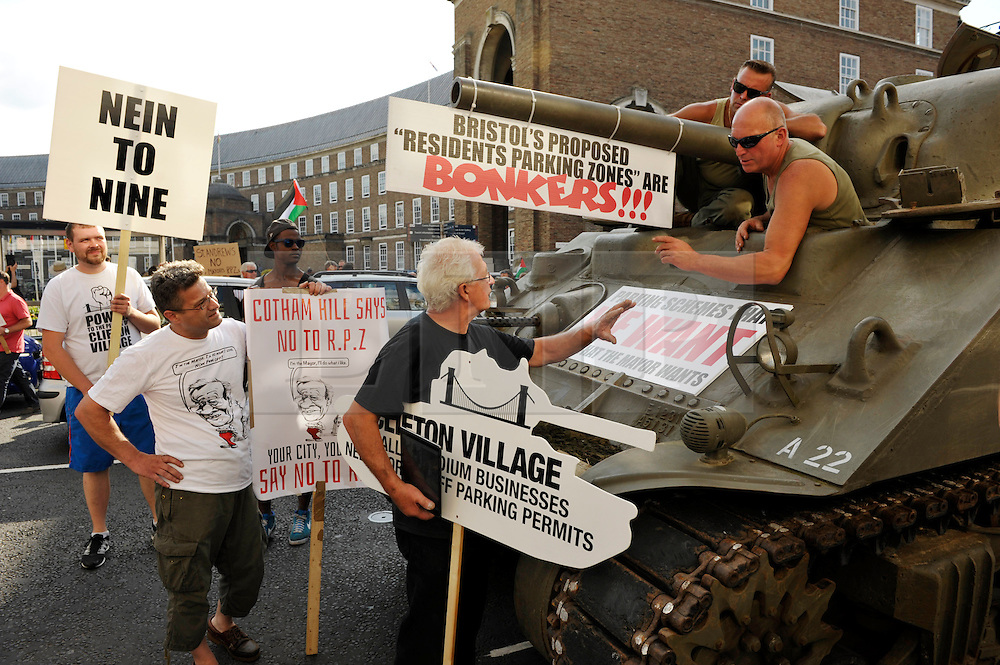© Licensed to London News Pictures. 22/07/2014; Bristol, UK.  A WW2 Sherman tank is used in a protest against Residents Parking Zones (RPZ) in Bristol, before a meeting of the City Council where the elected Mayor George Ferguson faces a debate of no confidence in his handling of RPZ.  The protest was partly organised by Tony Miles aka Smiley Miley from the Radio One Roadshow (pictured in black t-shirt).<br /> Photo credit: Simon Chapman/LNP