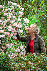 Carol Klein smelling Rhododendron 'Lady Alice Fitzwilliam'