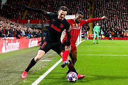 Georginio Wijnaldum of Liverpool challenges Saul Niguez of Atletico Madrid - Mandatory by-line: Robbie Stephenson/JMP - 11/03/2020 - FOOTBALL - Anfield - Liverpool, England - Liverpool v Atletico Madrid - UEFA Champions League Round of 16, 2nd Leg