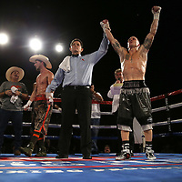Ricky Tomlinson fights James Burns during a Fire Fist Boxing Promotions boxing match at the A La Carte Pavilion on Saturday, August 12 , 2017 in Tampa, Florida.  (Alex Menendez via AP)