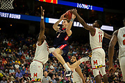 Belmont guard Dylan Windler (3) is fouled by Maryland guard Darryl Morsell (11) as he drives to the basket during the second half of the first round men's college basketball game in the NCAA Tournament, in Jacksonville, Fla. Thursday, March 21, 2019. (AP Photo/Stephen B. Morton)