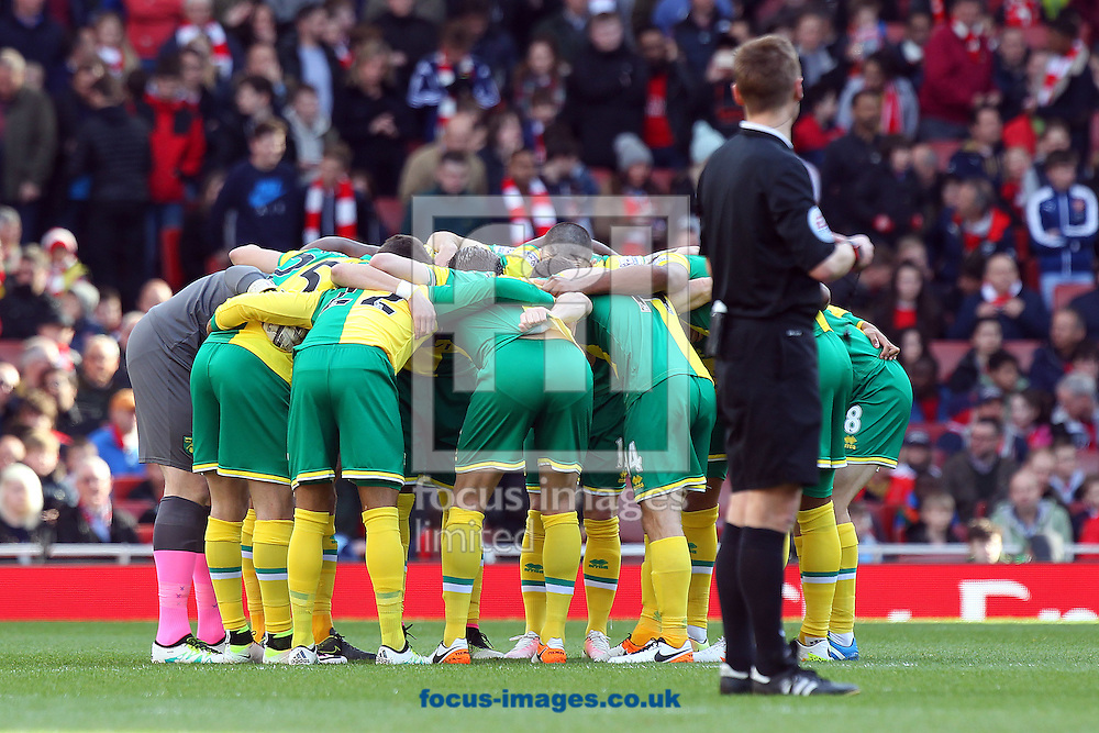 The Norwich players in the pre match huddle before the Barclays Premier League match at the Emirates Stadium, London, UK.<br /> Picture by Paul Chesterton/Focus Images Ltd +44 7904 640267<br /> 30/04/2016