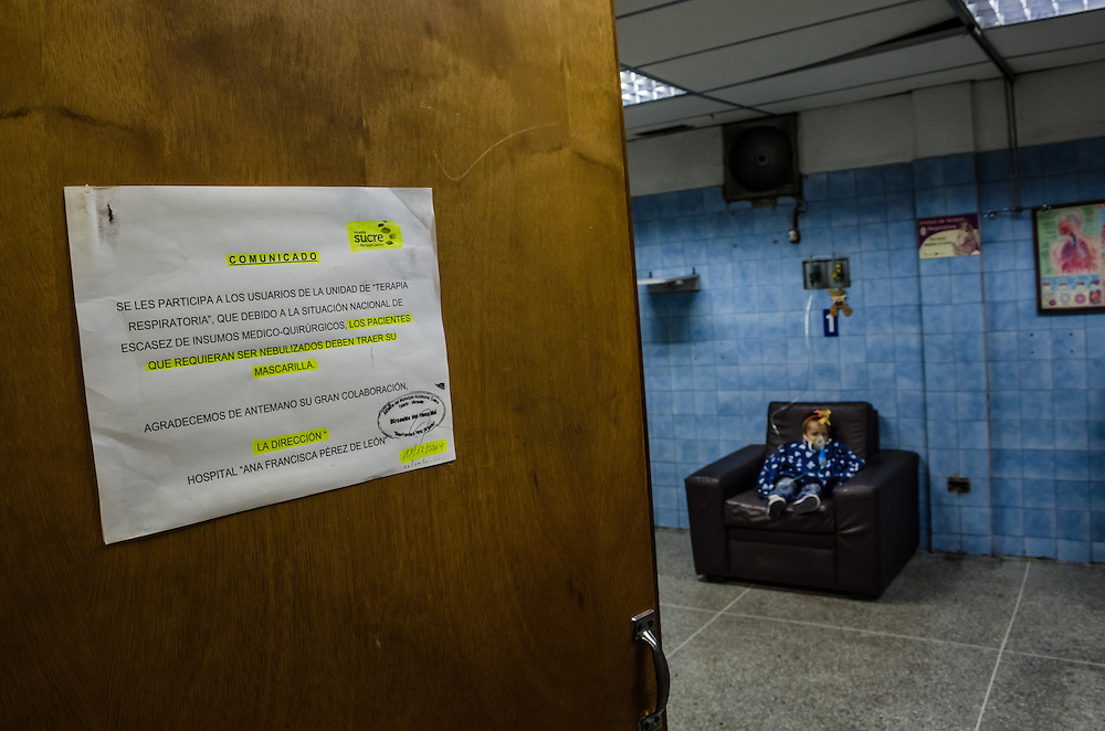 CARACAS, VENEZUELA - JANUARY 21, 2015: A sign that instructs patients to bring their own masks for asthma treatments on the door of the pediatric ward of a state-hospital in the Petare slum in Caracas.  Despite being a petro-state with one of the largest oil reserves in the world, basic and advanced medical supplies from gauze and surgical gloves, to heart stints, are difficult to find in hospitals and pharmacies across Venezuela.