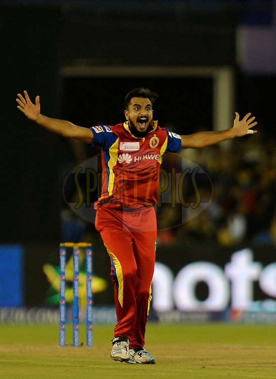 Harshal Patel of Royal Challengers Bangalore appeals successfully for the wicket of Ajinkya Rahane of Rajasthan Royals during match 22 of the Pepsi IPL 2015 (Indian Premier League) between The Rajasthan Royals and The Royal Challengers Bangalore held at the Sardar Patel Stadium in Ahmedabad , India on the 24th April 2015.<br /> <br /> Photo by:  Pal Pillai / SPORTZPICS / IPL