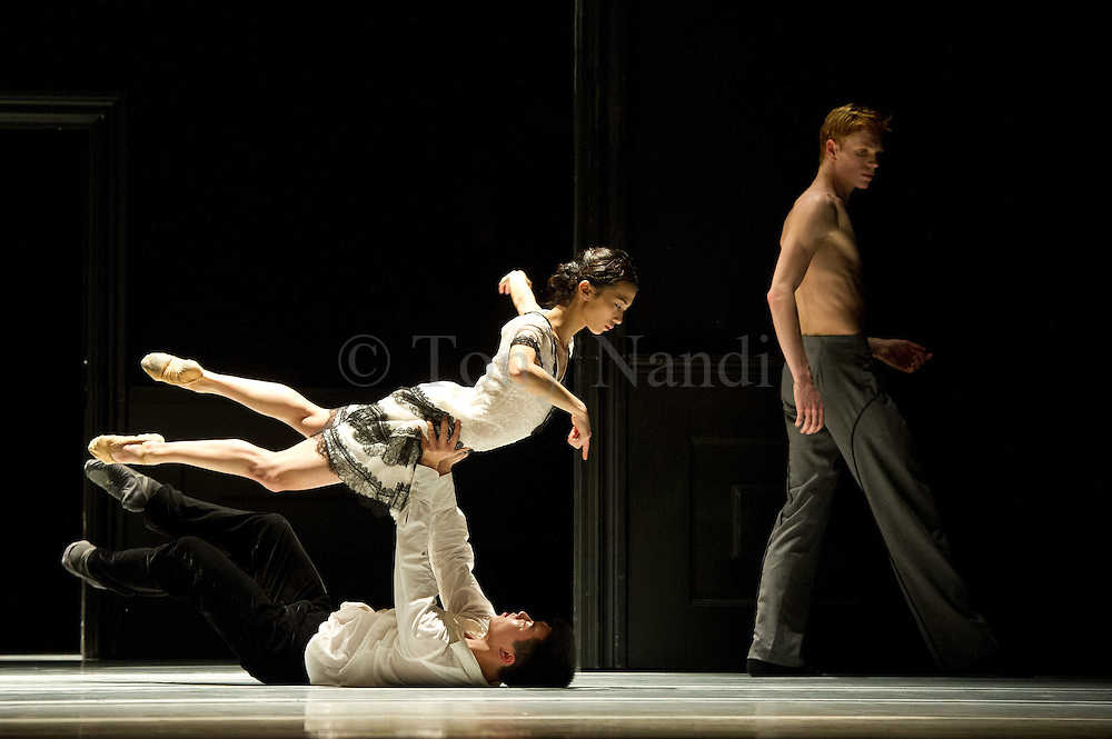 06/03/2012. London, UK. Founded in 1978, NDT2 is the younger company of Nederlands Dans Theater and has established a reputation for the astounding technique and boundless energy of its dancers, who are aged between 17 and 23 years. Picture shows Passe-Partout by NDT Artistic Director Paul Lightfoot, and features Jianhui and Meng-Ke Wu .