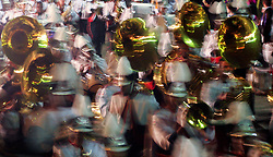 Feb 23rd, 2006. New Orleans, Louisiana. The Krewe of Muses. Muses is the only all women's Krewe to parade in New Orleans and is known for its satire, famous shoe throws and is generally considered one of the most popular parades of the Mardi Gras. Crowds scream and cheer for beads and throws from the famous Krewes' floats as they roll along St Charles Avenue. Marching bands walk the route providing music for the revelry.