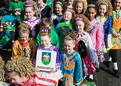 London, March 13th 2016. The annual St Patrick's Day Parade takes place in the Capital with various groups from the Irish community as well as contingents from other ethnicities taking part in a procession from Green Park to Trafalgar Square.  PICTURED: A troupe of young Irish dancers make their way to their position in the procession. &copy;Paul Davey<br /> FOR LICENCING CONTACT: Paul Davey +44 (0) 7966 016 296 paul@pauldaveycreative.co.uk