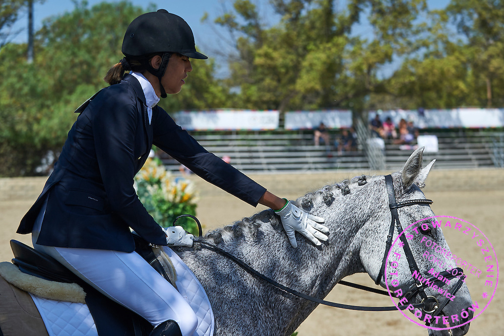 SO Poland athlete Marta Borowska with horse called Sinatra competes in equestrian competition during eighth day of the Special Olympics World Games Los Angeles 2015 on August 1, 2015 at Equestrian Centre Riverside Drive Burbank in Los Angeles, USA.<br /> USA, Los Angeles, August 1, 2015<br /> <br /> Picture also available in RAW (NEF) or TIFF format on special request.<br /> <br /> For editorial use only. Any commercial or promotional use requires permission.<br /> <br /> Adam Nurkiewicz declares that he has no rights to the image of people at the photographs of his authorship.<br /> <br /> Mandatory credit:<br /> Photo by &copy; Adam Nurkiewicz / Mediasport