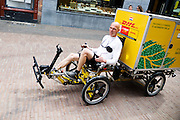 In Utrecht rijdt DHL met een special bakfiets voor de stadsdistributie. De fiets is gemaakt door Flevobike.<br /> <br /> In Utrecht DHL is delivering packages with a special cargo bike.