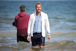 © Licensed to London News Pictures. 17/07/2017. Holkham UK. TV presenter Ben Fogle at Holkham beach this morning to watch The Queen's Household Cavalry take their horses for a splash in the surf at Holkham beach this morning as part of their summer break & training at Bodney camp. Photo credit: Andrew McCaren/LNP