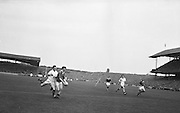 GAA All Ireland Minor Football Final Kerry v Mayo 23rd September 1962 Croke park..Kerry minor Captain S. O'Mahoney in full flight with the ball closely tackled by Mayo defender D'O'leary ..23.9.1962  23rd September 1962..All Ireland SFC - Final.Kerry 1-12 | Roscommon 1-6.Time: Unknown, Venue: Croke Park.Referee: E. Moules (Wicklow).Captain: S.g Sheehy..Attendance: 75,771