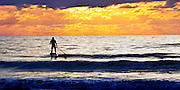Surf Paddler at Cocoa Beach, Florida - Riding into the Sunrise - Panorama